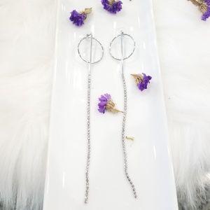 Silver dangily righnstone earrings